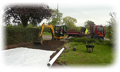 a photo of our workforce preparing a driveway for asphalting
