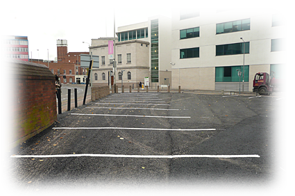 a photo of an open asphalt air car park