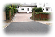 an image of an impressive tarmac and brick pattern house driveway